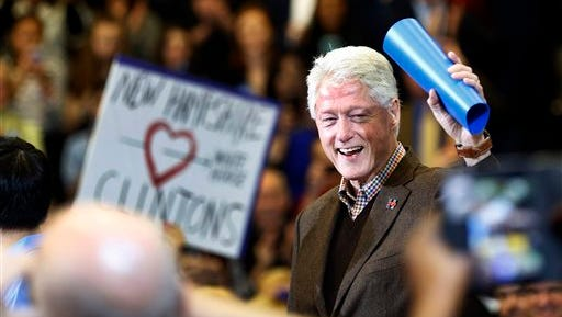 Former President Bill Clinton waves to a cheering crowd as he arrives during a campaign stop for his wife, Democratic presidential candidate Hillary Clinton, Monday, Jan. 4, 2016, in Nashua, N.H.