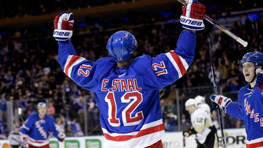 The Rangers' Eric Staal (12) celebrates one of his two goals Sunday against Pittsburgh at the Garden.