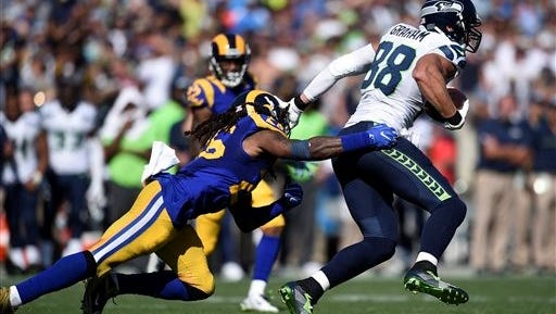 Seattle Seahawks tight end Jimmy Graham (88) runs after a catch defended by Los Angeles Rams linebacker Mark Barron. Barron faces his former team in Tampa Bay this weekend.