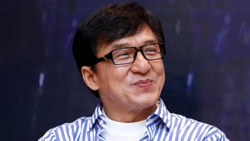 """FILE - In this Dec. 18, 2013, file photo, Hong Kong actor Jackie Chan smiles during a news conference to promote his new film """"Police Story 2013,"""" in Kuala Lumpur, Malaysia. On Saturday, Nov. 12, 2016, Chan will accept an honorary Academy Award from the film academy's Board of Governors."""