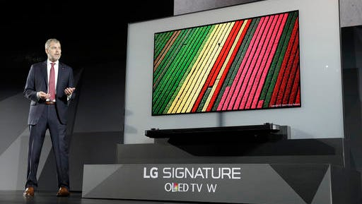David VanderWaal, vice president of marketing for LG Electronics USA, unveils the LG Signature OLED TV W during an LG news conference before CES International, Wednesday, Jan. 4, 2017, in Las Vegas.