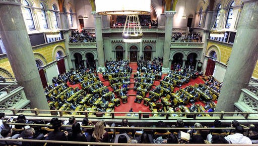 Members of the New York state Assembly meet in the Assembly Chamber at the Capitol on the opening day of the legislative session on Wednesday, Jan. 4, 2017, in Albany, N.Y.