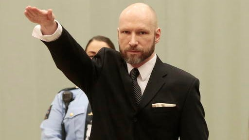 Anders Behring Breivik raises his right hand at the start of his appeal case in Borgarting Court of Appeal at Telemark prison in Skien, Norway, Tuesday, Jan. 10, 2017. Norwegian mass murderer Anders Behring Breivik walked quietly into a courtroom at a high security prison Tuesday, making a neo-Nazi salute, as judges began reviewing a government appeal against a ruling that his solitary confinement was inhumane and violated human rights.
