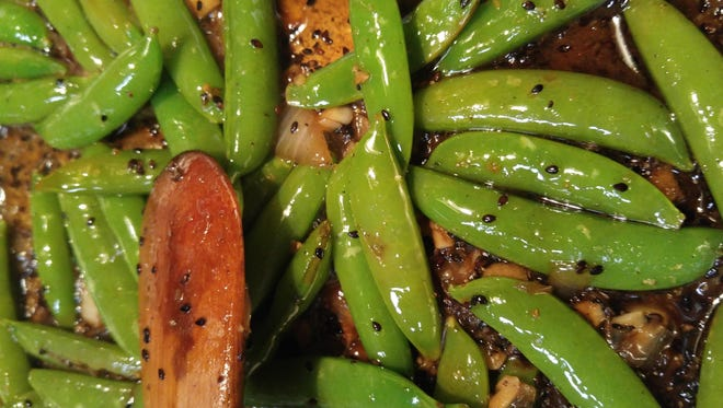 Sugar snap peas are delicious raw but can also be sauteed lightly with butter for a great side dish.