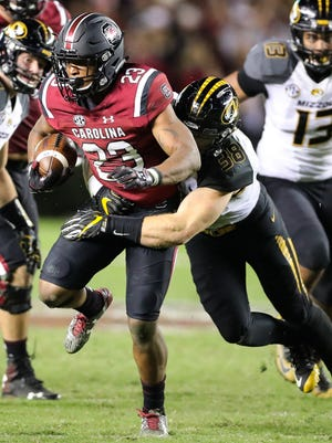 Missouri linebacker Eric Beisel (38) wraps up South Carolina running back Rico Dowdle (23) during the teams' 2016 meeting.