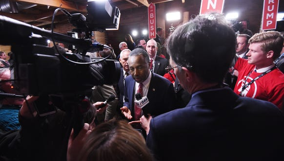 Ben Carson speaks to the media in the spin room after
