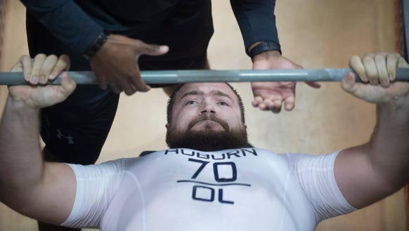 Auburn offensive lineman Robert Leff (70) bench presses