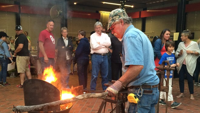 Larry Roderick fires up scrap metal that he turned into 36-inch samurai swords at the After Hours Artwalk May 4. The next Artwalk is June 1. Head downtown, where art galleries, restaurants and other businesses are open late and the Downtown Farmers Market filled with artists.