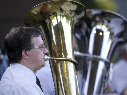 Jim Dorschner, with the Appleton City Band, plays the tuba during their performance Tuesday at Pierce Park in Appleton.