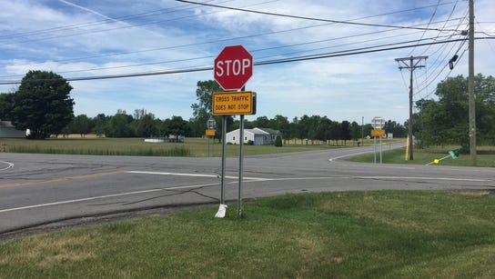 "A new stop sign and ""cross traffic does not stop"" placard"