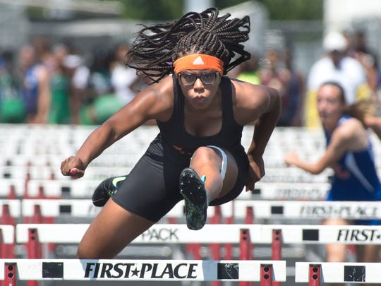 Dunbar High School's TeNiya Jones competes in the girls 100-meter hurdles at the Lee County Athletic Conference Championship, March 21, 2015 at South Fort Myers High School. Jones disappeared Saturday while swimming in the Mediterranean Sea near a Tel Aviv, Israel beach.