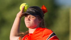 Powell's Lillian Holston (60) throws to first during