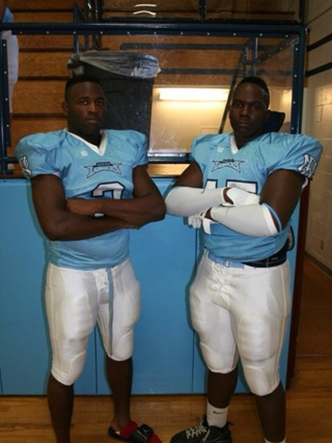 Vernon Butler, right, poses for a photo back in high