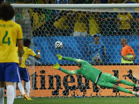 Brazil's Neymar scores on a penalty kick as Croatia's Stipe Pletikosa tries to save it during the 2014 World Cup opening match Thursday.