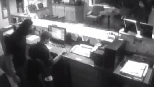 Screen capture of Fountain Park Motel robbery.