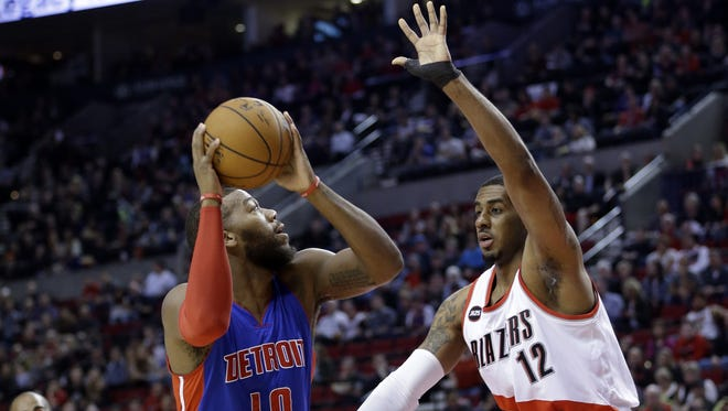 Detroit Pistons forward Greg Monroe, left, looks to shoot against Portland Trail Blazers forward LaMarcus Aldridge during the first half in Portland on Friday, March 13, 2015.