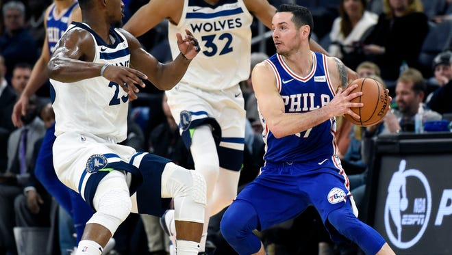 Minnesota Timberwolves guard Jimmy Butler (23) and center Karl-Anthony Towns (32) guard Philadelphia 76ers forward JJ Redick (17) during overtime of an NBA basketball game on Tuesday, Dec. 12, in Minneapolis. The 76ers won 118-112.
