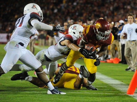USC running back Javorius Allen (37) moves the ball in for a touchdown on Oct. 10, 2013, against the Arizona Wildcats at the Los Angeles Memorial Coliseum.