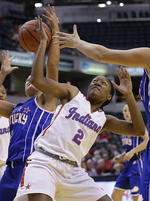 Indiana's Jayla Scaife fights for a rebound with Kentucky's Mikayla Berry in the All-Stars game Saturday, June 11, 2016, at Bankers Life Fieldhouse.