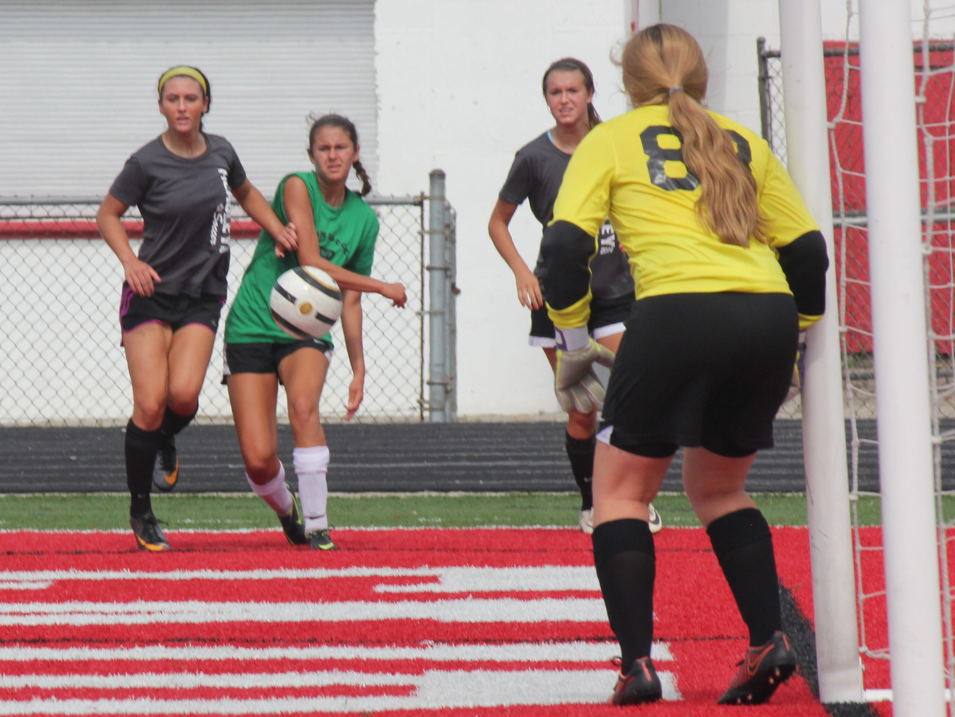 Badin's Malia Berkely takes a shot against McAuley's keeper in their game July 12 at Fairfield.