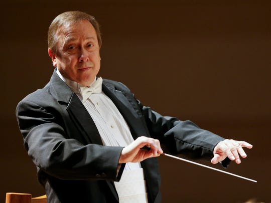 Great Falls Symphony music director and conductor, Gordon Johnson conducts the orchestra in the Mansfield Theater .