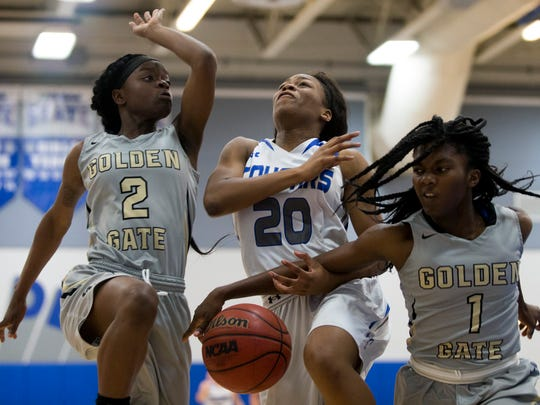 Golden Gate's Chim'sly Pericles (1) strips the ball from Barron Collier's Jada McCray (20) as Mia Francois (2) also defends in the first half of action during the Class 7A-District 12 title game Friday, Feb. 3, 2017 in Naples. Barron Collier led 31-13 at the half.