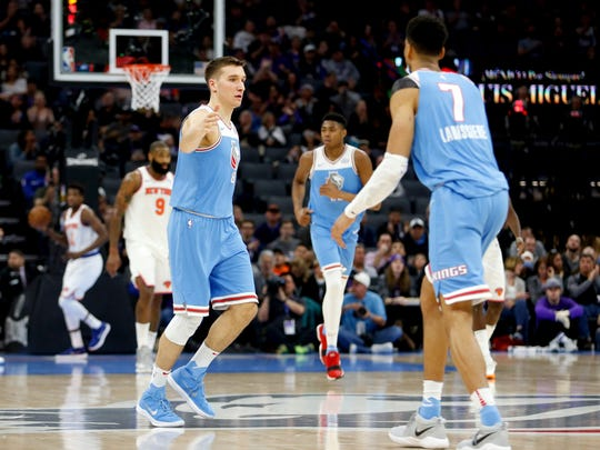 Sacramento Kings guard Bogdan Bogdanovic (8) celebrates with teammate Skal Labissiere (7) after scoring against the New York Knicks in the second quarter at Golden 1 Center.