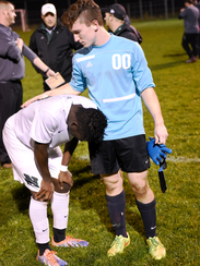 Novi goalkeeper Luke McDonald (right) consoles teammate