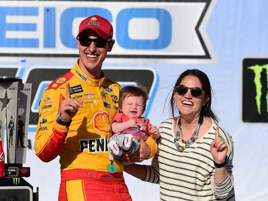 Joey Logano with his wife, Brittany, and baby Hudson at Talladega Superspeedway in 2018. (Jared C. Tilton/Getty Images)