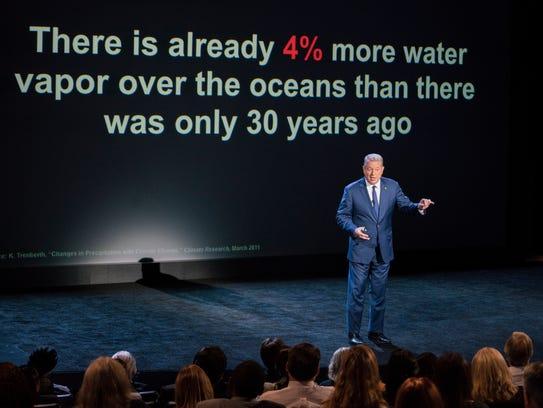 "Al Gore gives a presentation in ""An Inconvenient Sequel:"