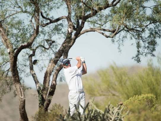 Stuart Smith hits his tee shot on the fourth hole during