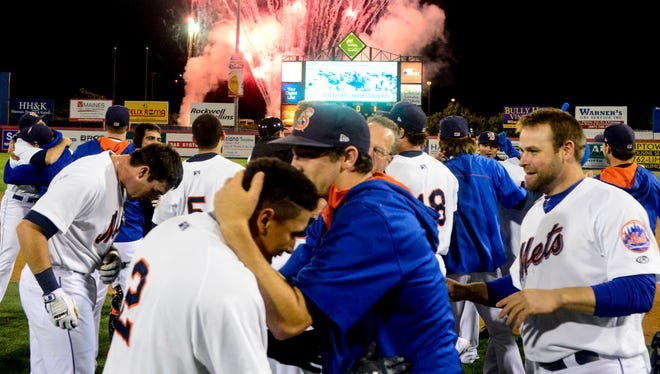 Members of the Binghamton Mets run onto the field after winning the Eastern League Championship at NYSEG Stadium on Friday.