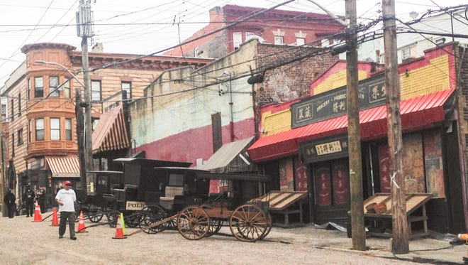"A street in Yonkers is transformed for filming the show ""The Knick"" in Yonkers on Wednesday."