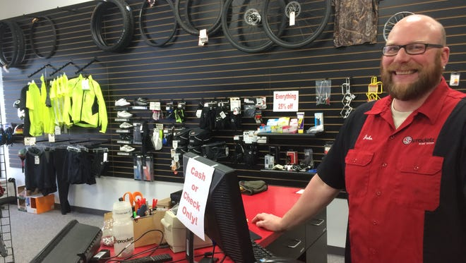 John Nowaczyk, the owner of the Weston bike shop Sprocketz, is shutting the store's doors, and will be the new manager of the Trek Bicycle Store of Wausau.