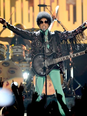 Musician Prince performs onstage during the 2013 Billboard Music Awards at the MGM Grand Garden Arena on May 19, 2013 in Las Vegas.
