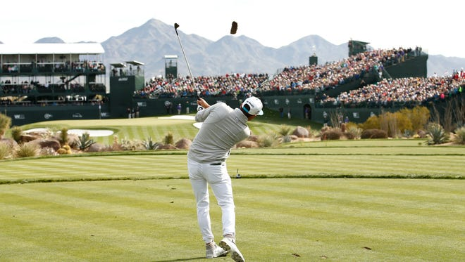 Rickie Fowler hits his tee shot on the 16th hole during the first round of the Waste Management Phoenix Open golf tournament at TPC Scottsdale in Scottsdale, Ariz., on Thursday, Feb. 4, 2016.