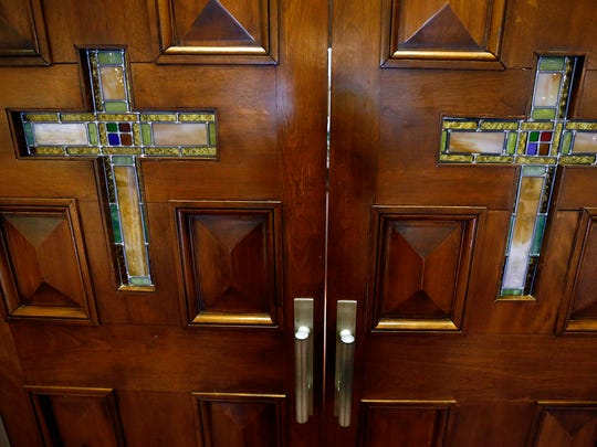 Stained glass crosses are seen on the doors to the sanctuary at First Baptist Church, Capitol Hill on April 22, 2018, in Nashville.