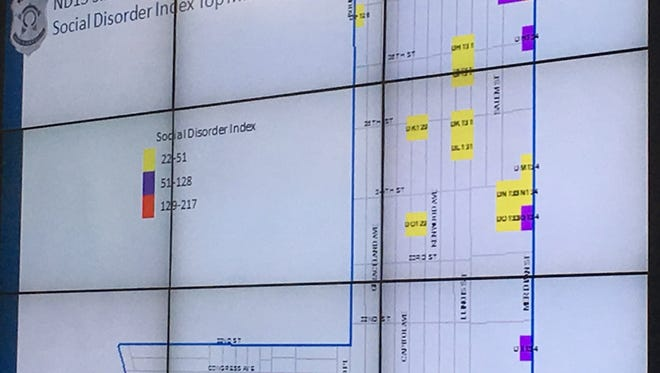 A map details the Indianapolis Metropolitan Police Department's new tool to help target crime. The colored grids show the areas in the North District with the highest prevalence of crime.