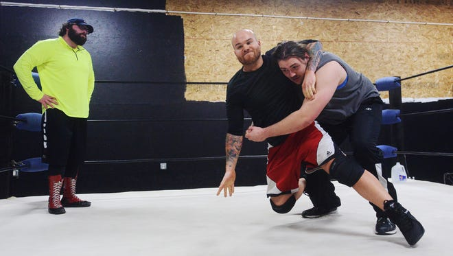 """Jordon Sterrett takes down Jeremy Gayken as they train with former WWE wrestler Nick """"Eugene"""" Dinsmore recently at the Midwest All Pro training center in Tea."""