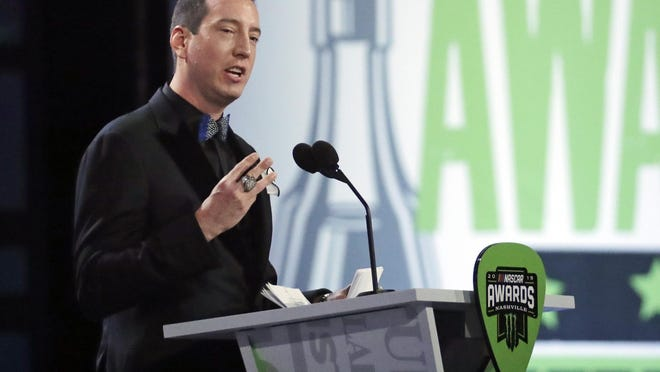 Champion Kyle Busch speaks as he is honored at the 2019 NASCAR Cup Series Awards ceremony.