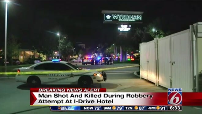 A 52-year-old man was shot and killed early Thursday during a robbery attempt at a resort in the tourist district of Orlando, deputies said.