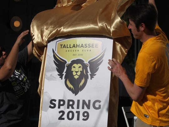 Tallahassee Soccer Association president Noah Roberts and a board member with the newly create Tallahassee soccer Club, reveals the new Battle Lions logo the semi-pro team will use. The name is an historic homage to Dale Mabry Army Airfield and how it shaped Tallahassee.
