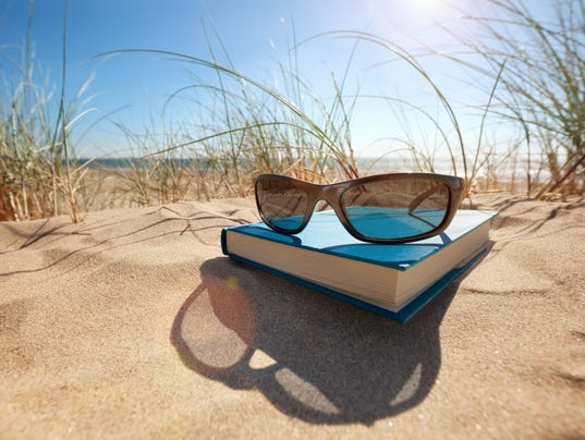 Book and sunglasses