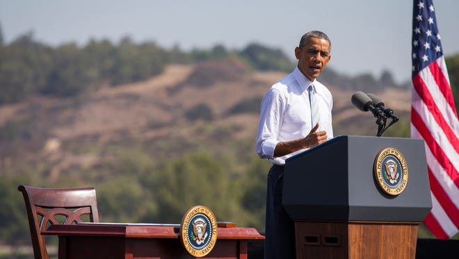 President Barack Obama speaks at Frank G. Bonelli Regional Park  in San Dimas, Calif.,  Friday, Oct. 10, 2014. Obama designated the nearly 350,000 acres within the San Gabriel Mountains northeast of Los Angeles a national monument. Supporters say the move will provide recreational opportunities for millions of people _ minorities and children in particular _ who live in Los Angeles County, one of the most disadvantaged areas in terms of access to open space. Local officials worry about potential use restrictions (AP Photo/Evan Vucci) ORG XMIT: CAEV103