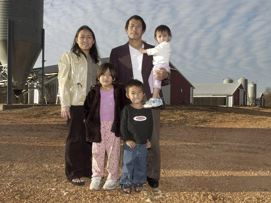 Blong Thao, his wife Yia Yang and their three children