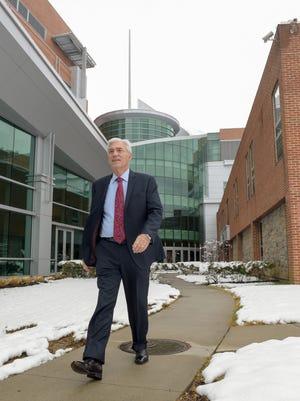 John Lloyd, president and CEO of Meridian Health, strolls outside Jersey Shore University Medical Center in Neptune.
