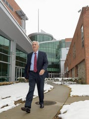 John Lloyd, president and CEO of Meridian Health, strolls outside Jersey Shore University Medical Center in Neptune.