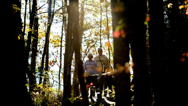 Visitors walk under on the Laurel Falls trail in Great Smoky Mountain National Park on  Oct. 26, 2017. A woman was hospitalized after falling 40 feet near the falls on Monday.