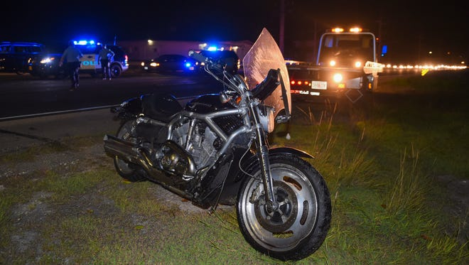 A damaged Harley-Davidson V-Rod stands at the scene of an accident in Asan near the JWS showroom. Guam Fire Department units responded to a call at 7:10 p.m. for a motorcycle accident with serious injuries.