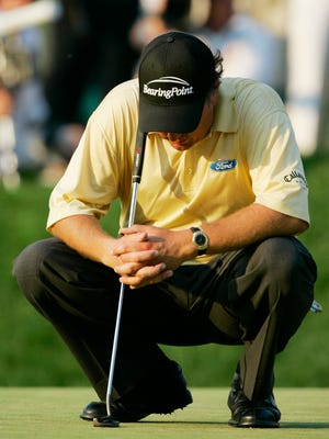 FILE - In this June 18, 2006, file photo, Phil Mickelson, of the United States, waits to putt on the 18th green in the final round of the U.S. Open at Winged Foot Golf Club in Mamaroneck, N.Y. Mickelson lost to Geoff Ogilvy of Australia. Mickelson is now exempt to return to Winged Foot for the U.S. Open in September.